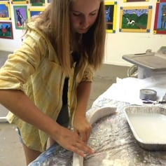 Taegan Making a Plaster Elephant Tusk