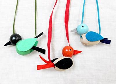 Three finished beaded bird necklaces