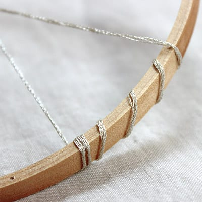 Closeup of string wound around the edge of the dreamweaver