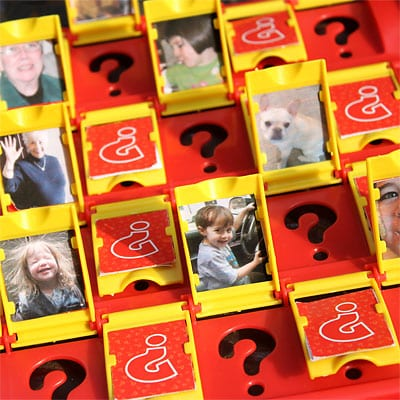 Guess Who® Game with our own family photos closeup of red board