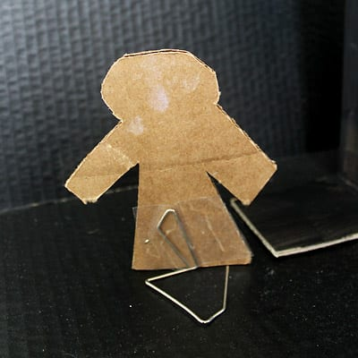 Closeup of cardboard town person with paperclip stand