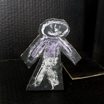 Finished cardboard person with chalk outline