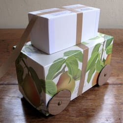 Almost finished cardboard car with wheels turned with top attachment. Just need to paint!