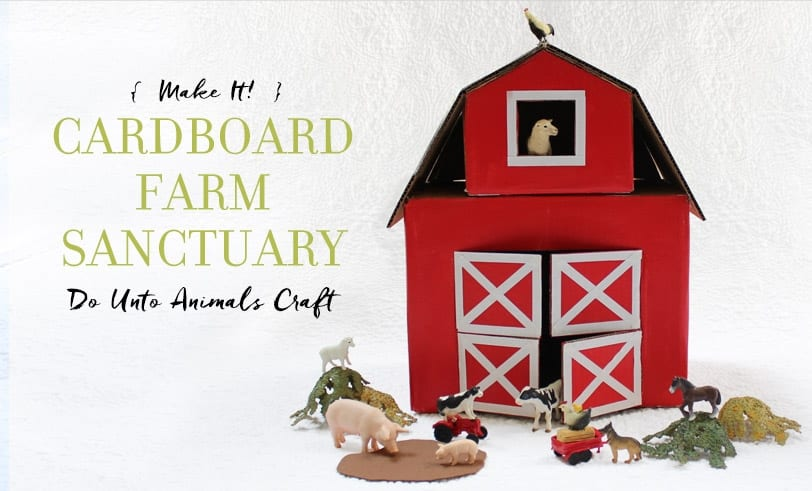 Red crafted barn with farm animal figurines