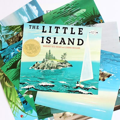 The Little Island book cover on top of fanned out pages from the book.