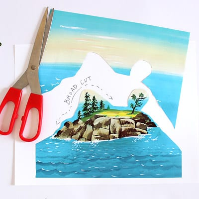 Scissors and an illustration from The Little Island book showing a broad cut.