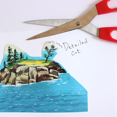 Scissors and an illustration from The Little Island book showing a detailed cut.