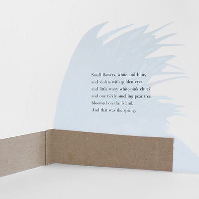 The back side of a foliage illustration cut out and pasted to a folded piece of medium weight craft paper, so that the illustration stands independently.