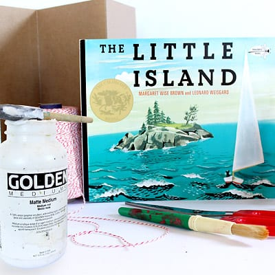 Materials needed to create The Little Island Accordion book: the book itself, modge podge, foam brush, paint brush, scissors, string, and medium weight craft paper.